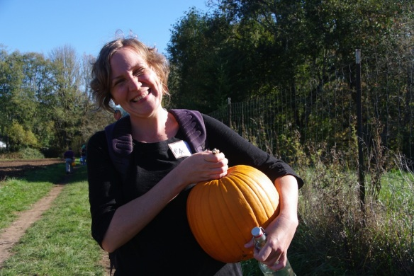 A happy CSA member with her pumpkin
